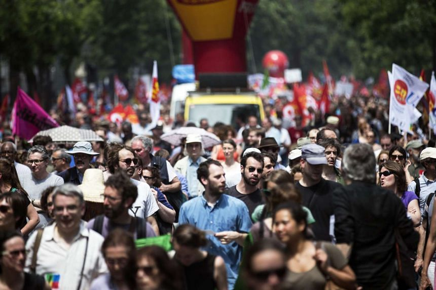 Protestors participate in a national demonstration against the Labor Law reform in Paris on June 23, 2016.