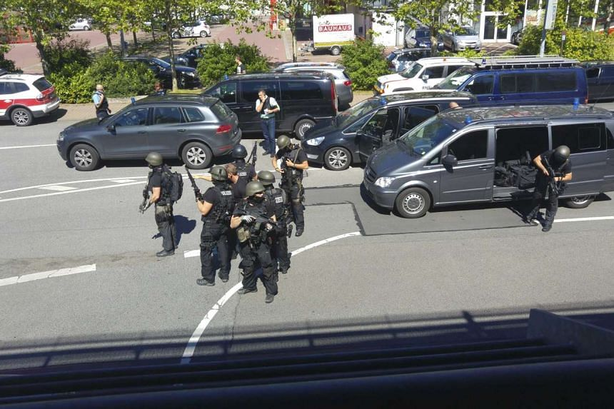 German special forces police deploying near the Kinopolis cinema complex after a masked man started shooting, in Viernheim, near Frankfurt, on June 23, 2016.