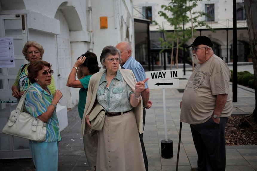 People wait in line to cast their ballots at a polling station in Gibraltar, historically claimed by Spain, June 23, 2016.