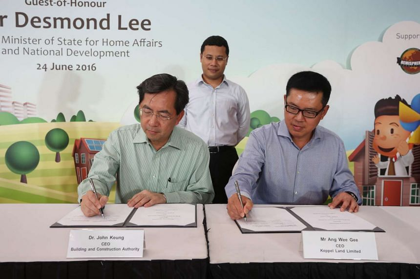 Senior Minister of State Desmond Lee witnesses the signing of the BCA-Keppel Land Partnership agreement by BCA's CEOJohn Keung and Keppel Land Limited's CEO Ang Wee Gee.