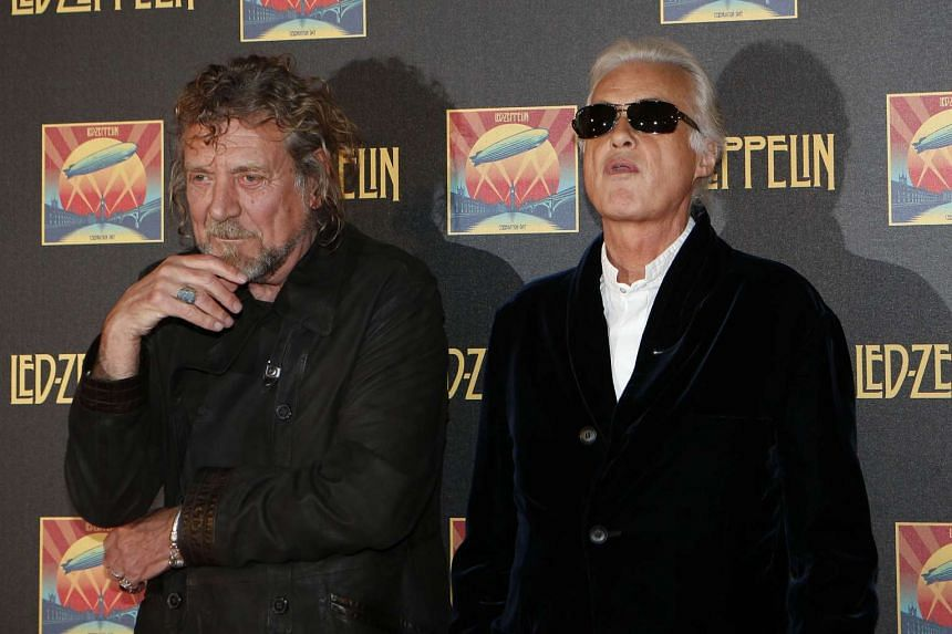 Led Zeppelin singer Robert Plant (left) and guitarist Jimmy Page pose for photographs as they arrive for the UK premiere of Celebration Day, on Oct 12, 2012.