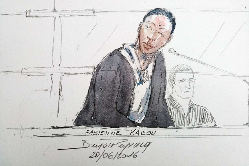 This court sketch made on June 20, 2016, shows Fabienne Kabou speaking on the first day of her trial at the Assize Court, in Saint-Omer.
