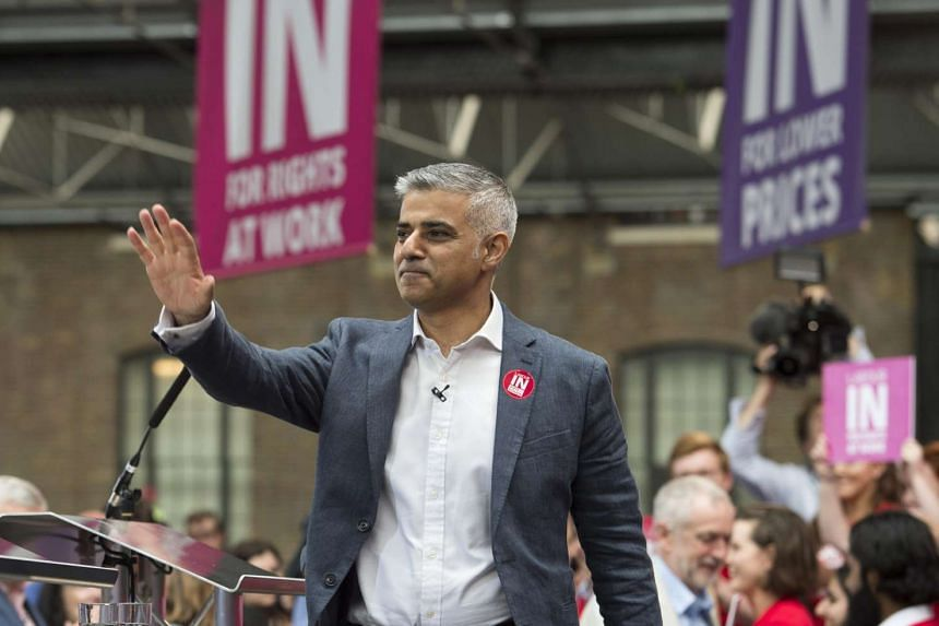 "London Mayor Sadiq Khan gestures before delivering a speech at a ""Vote Remain"" event in London, on June 22, 2016."
