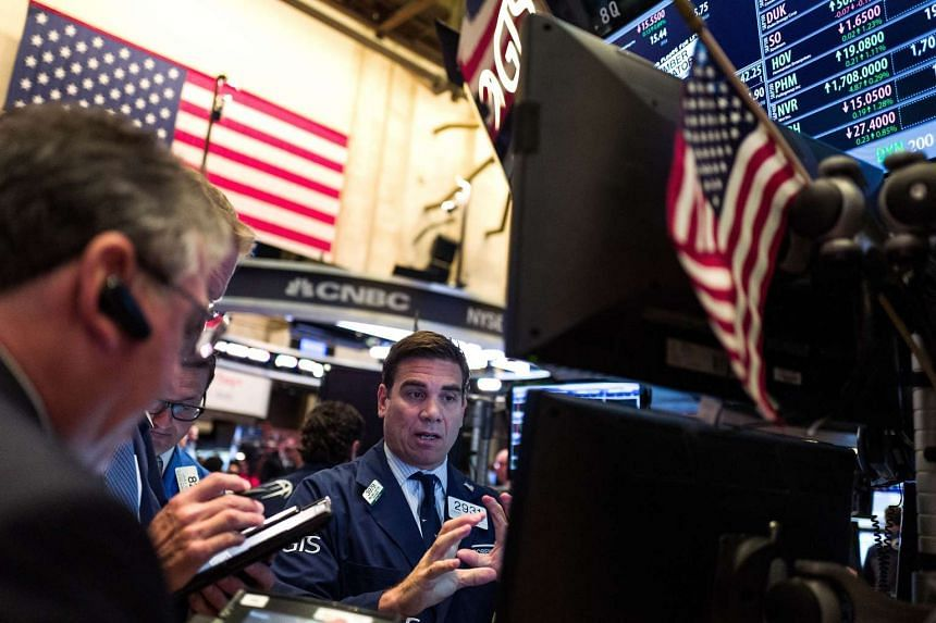 Traders and financial professionals work on the floor of the New York Stock Exchange, on June 23, 2016, in New York City.