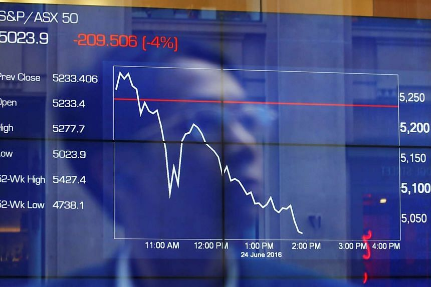 A man looks at a display board showing Australia's S&P/ASX 50 Index at the Australian Stock Exchange in Sydney, on June 24, 2016.