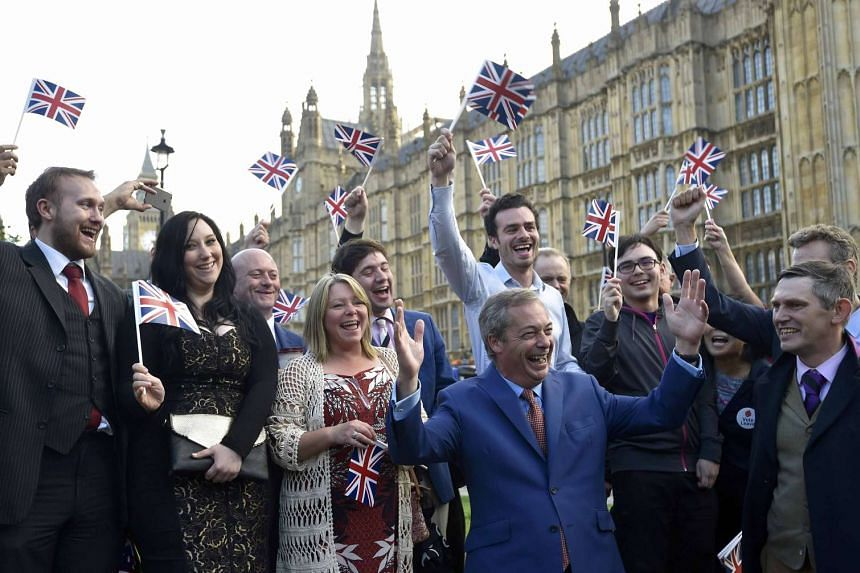 Nigel Farage (front), the leader of the United Kingdom Independence Party (UKIP), reacts with supporters following the result of the EU referendum.