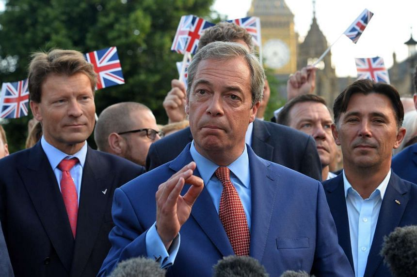 Nigel Farage speaks at a press conference near the Houses of Parliament in central London, on June 24, 2016.