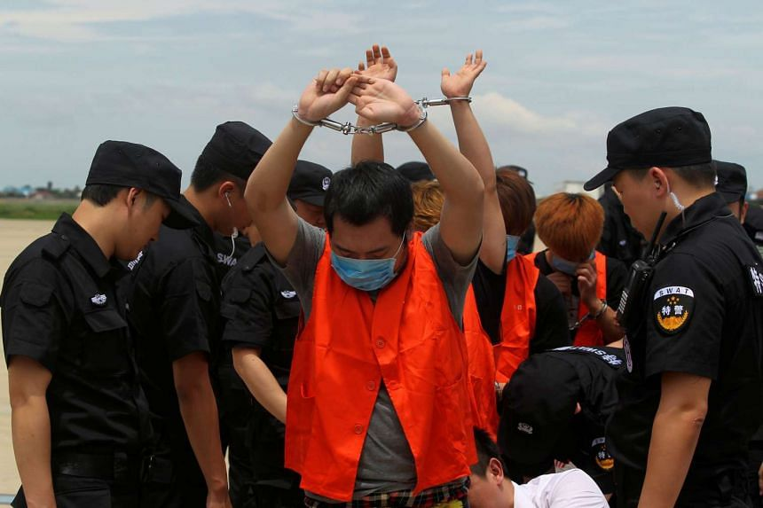 Taiwanese and Chinese nationals suspected of telecom fraud being deported to China at the International Airport of Phnom Penh, June 24, 2016.