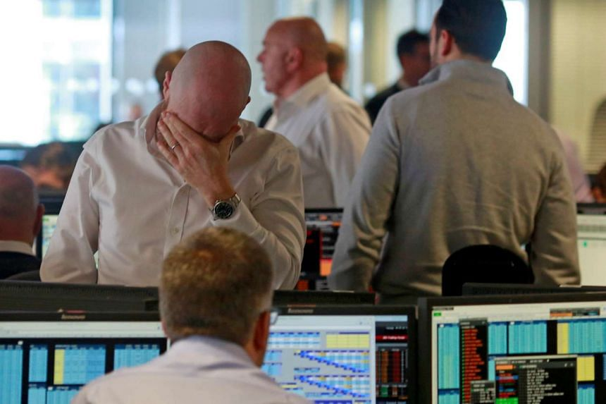 Traders from BGC, a global brokerage company in London's Canary Wharf financial centre, on June 24, 2016 after Britain voted to leave the European Union in a referendum.