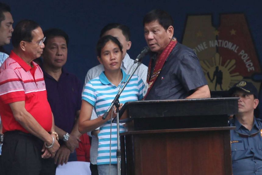 President-elect Rodrigo Duterte (second from right) talks to kidnap victim Marites Flor (centre), after she was released, in Davao city, on June 24, 2016.