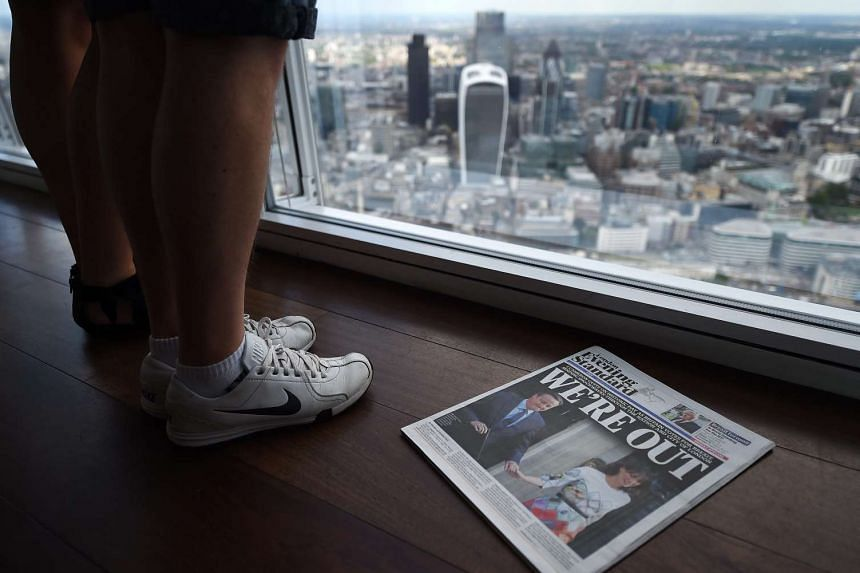 A newspaper showing news of Brexit lies atop the Shard overlooking the City of London on June 24, 2016.