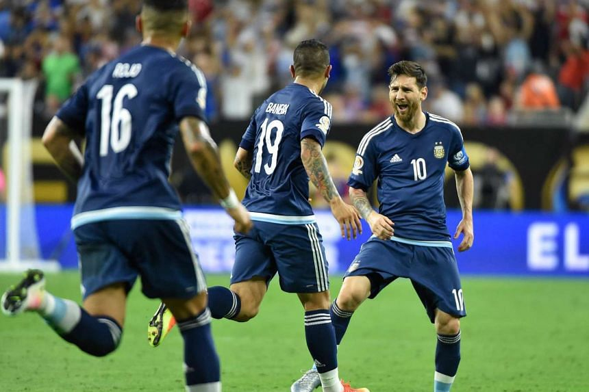 Argentina's Lionel Messi (right) celebrates with teammates after scoring a free-kick against USA during their Copa America Centenario semifinal football match.