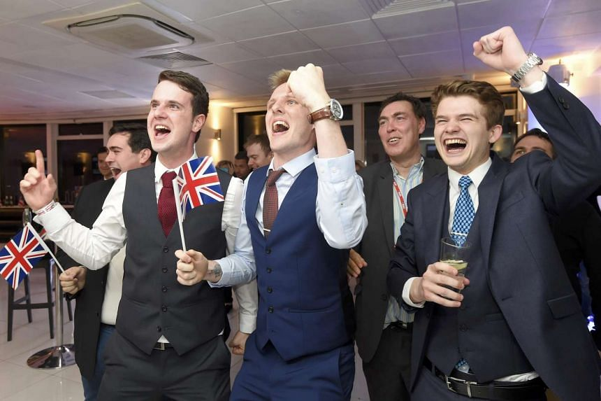 Leave supporters cheering results at a party after polling stations closed in London on June 23, 2016.