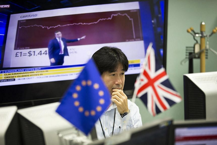 European Union and British flags at a foreign exchange brokerage in Tokyo on Friday (June 24).