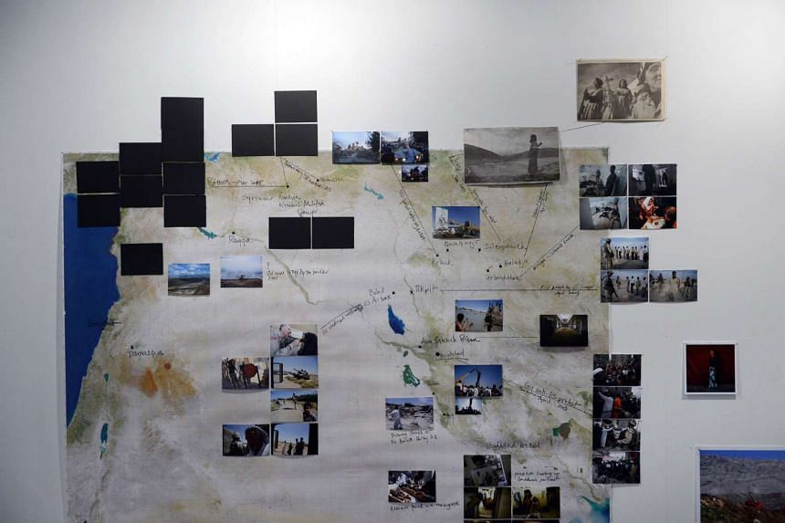 The wall panel of artist Newsha Tavakolian's exhibition at 72-13 Mohamed Sultan Road where 15 pictures were removed and replaced with black cards.