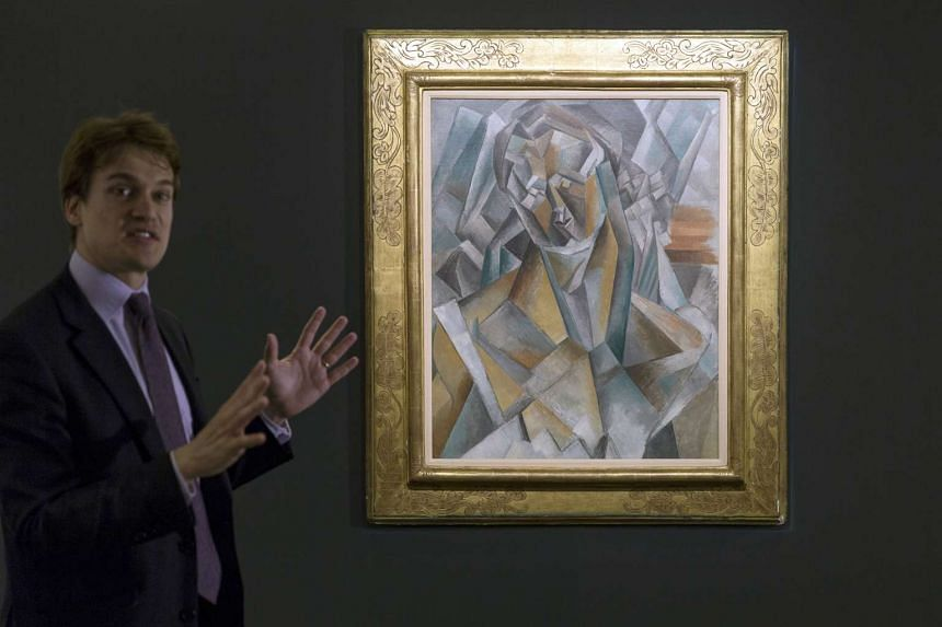 Picasso's Femme Assise, painted in 1909, sold for US$63.7 million (S$85 million) at Sotheby's in London on Tuesday, making it the most expensive Cubist painting ever sold at auction. The painting depicts Picasso's lover and model Fernande Olivi