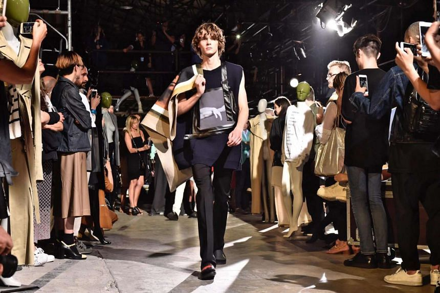 A model presents a creation by designer Raf Simons during the 90th edition of Pitti Uomo in Florence, Italy.
