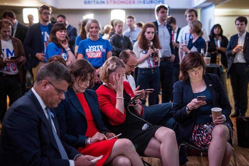 Remain supporters in London react as results of the EU referendum are announced early in the morning of June 24.