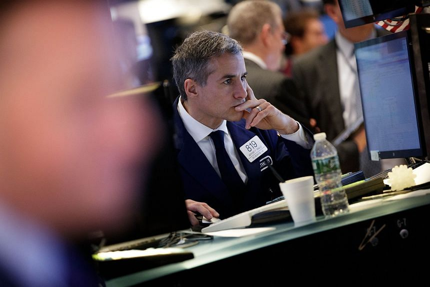Traders on the floor of the New York Stock Exchange on June 23.