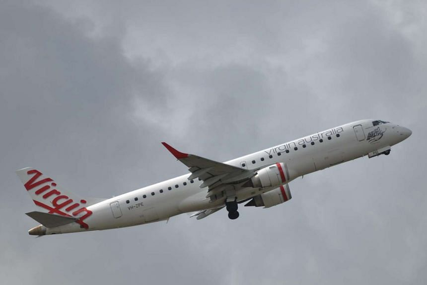 A Virgin Australia plane taking off at Sydney Airport.