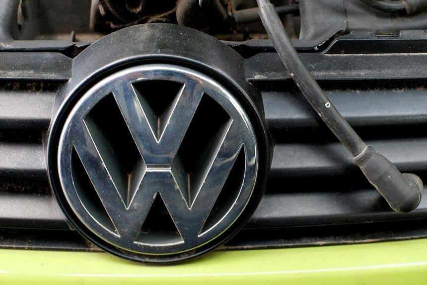 A Volkswagen logo is seen on a car's front at a scrapyard in Fuerstenfeldbruck, Germany.