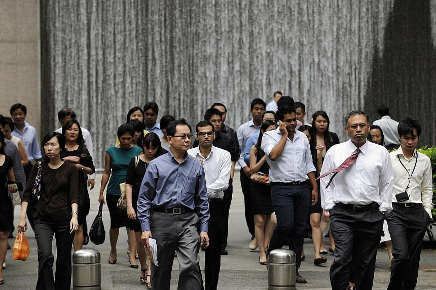Office workers walk through the central business district during lunch break in Singapore on Aug 5, 2010.