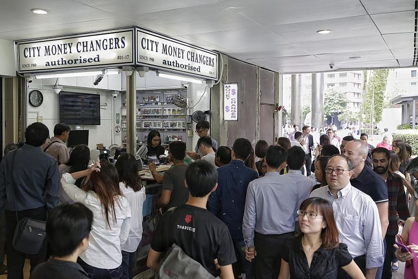 Crowds flocked to money changers in Raffles Place hoping to snap up sterling cheaply after the rate plunged.