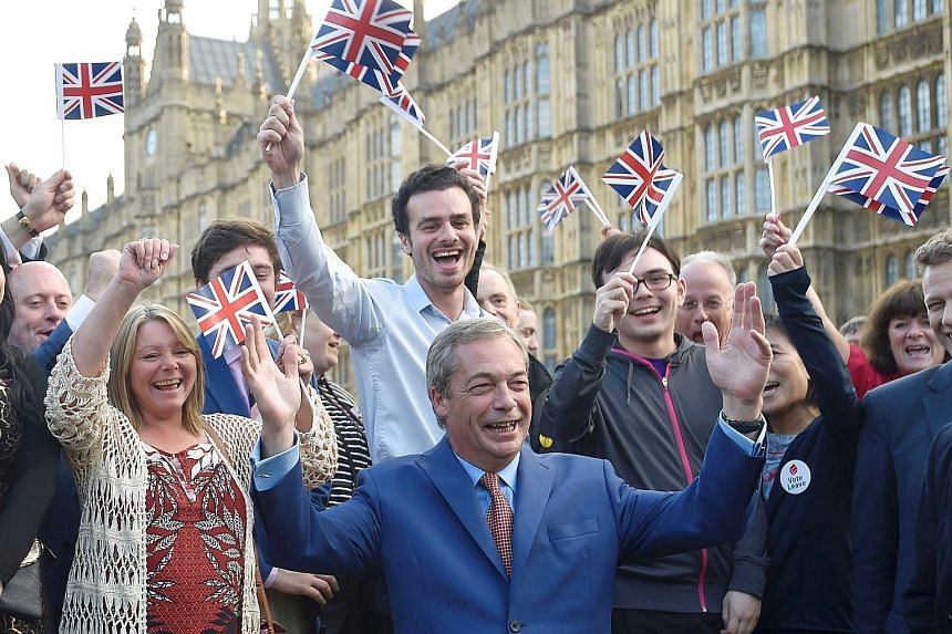 "UK Independence Party leader Nigel Farage and ""Leave"" supporters cheering the referendum outcome yesterday. He had said Prime Minister David Cameron should immediately resign if Brexit became a reality. A taxi driver in central London displaying a Un"