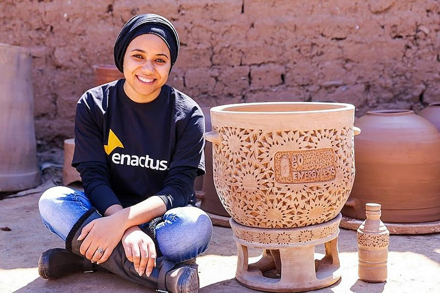Ms Lamhar with the fridge made with clay which her start-up Go Energyless developed. From extreme left: Tomatoes in different states of preservation: one left outside, one preserved in a classic fridge and one preserved under the concept developed by