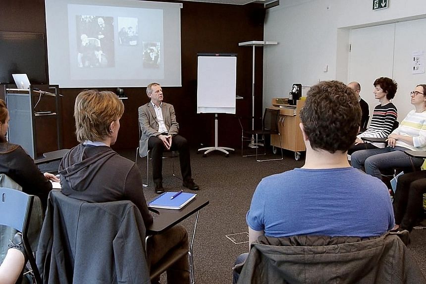 Psychiatrist Eric Bonvin during a lecture at a Swiss-French hypnosis institute. He says hypnosis has a similar effect to morphine.