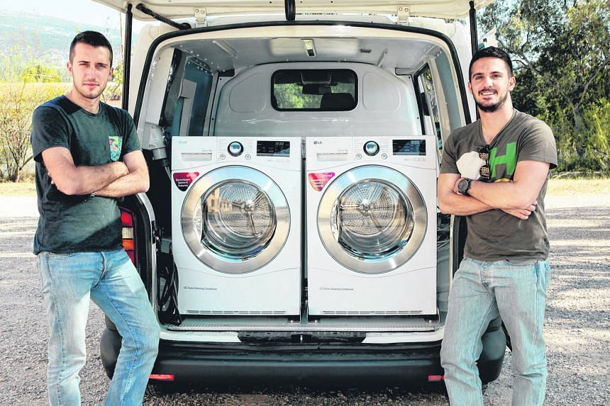 "Mr Spiliopoulos (left) and Mr Tsonas hope that their ""Ithaca Laundry"" - a van refitted with washing machines - will help the homeless improve their self-esteem and increase their dignity."