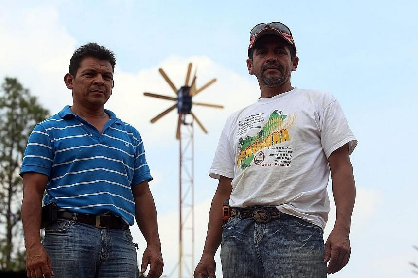 Mr Oscar Pagoada (far left) and Mr Javier Caceres were forced into action by the 12-hour electricity blackouts which affect remote Honduran communities.