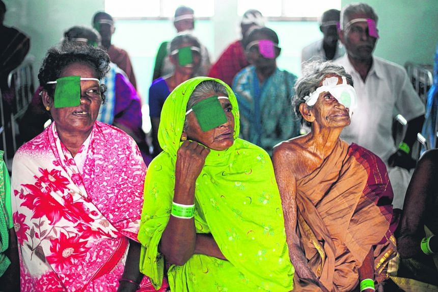 Left: Patients attending a counselling session on care after their cataract surgery at Aravind Eye Hospital in Madurai. Above: The hospital's Aurolab, which produces intraocular lens and suture needles at below market cost, helping to keep surgery co