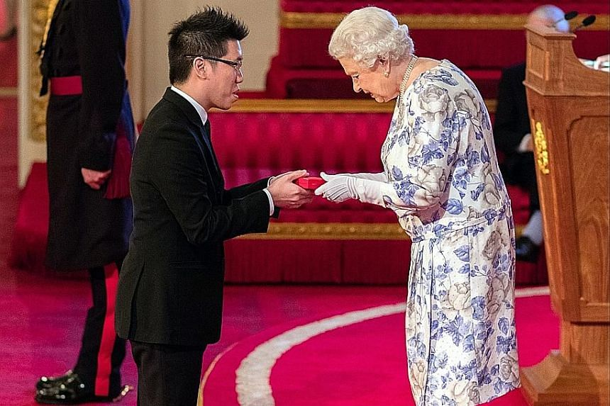 Mr Mark Cheng receiving his award from the queen at Buckingham Palace on Thursday. He is one of 60 young people from 45 Commonwealth countries honoured for transforming the lives of others and making a lasting impact on their communities.