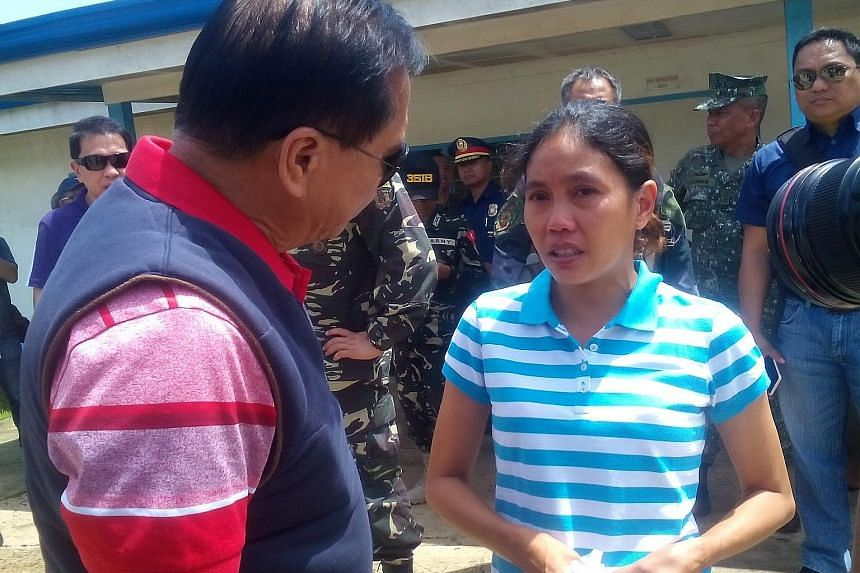 Ms Flor in Jolo, Sulu province, yesterday after her release on Thursday. She was abducted last year from an island resort in Davao province along with three foreigners. Two of them have been executed.