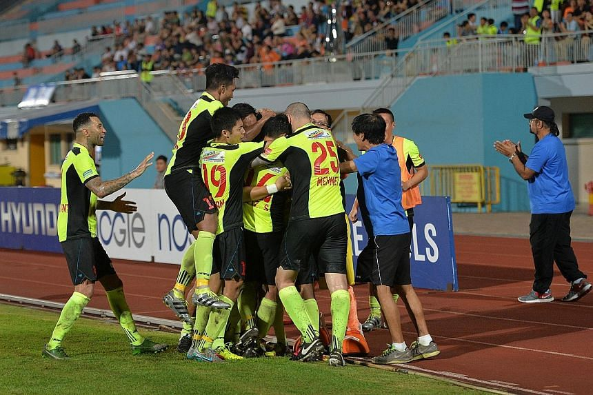 Tampines players celebrating Fazrul Nawaz's 80th-minute goal in the 1-0 win, which revived their chances with a third of the season left.