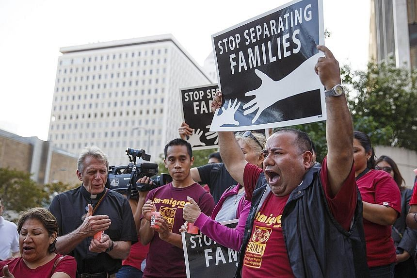 Immigrants and supporters in Los Angeles reacting after the US Supreme Court issued a split ruling on Thursday on President Barack Obama's immigration plan, effectively blocking it. The decision, however, could benefit Mrs Hillary Clinton in her bid