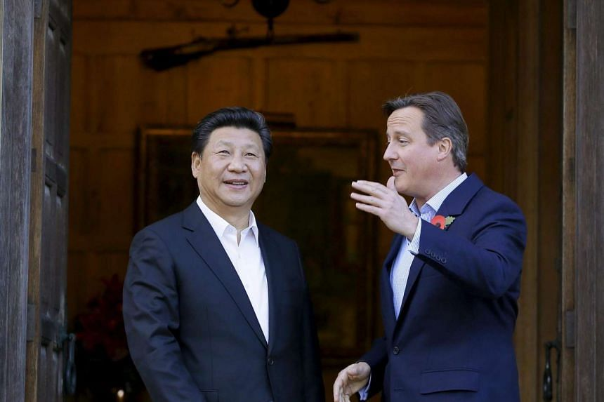 Britain's Prime Minister David Cameron (right) welcoming Chinese President Xi Jinping to his official residence at Chequers on Oct 22, 2015.