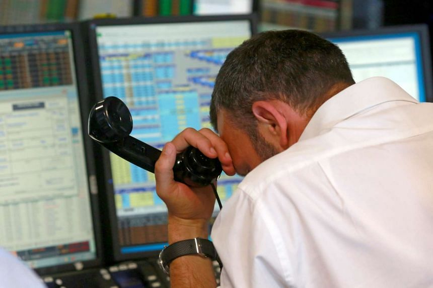A trader from BGC, a global brokerage company in London's Canary Wharf financial centre, reacts during trading June 24, 2016.