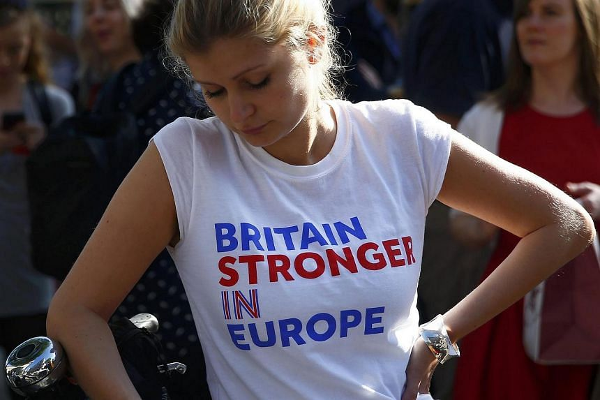 A woman wearing a Remain T-shirt in London.
