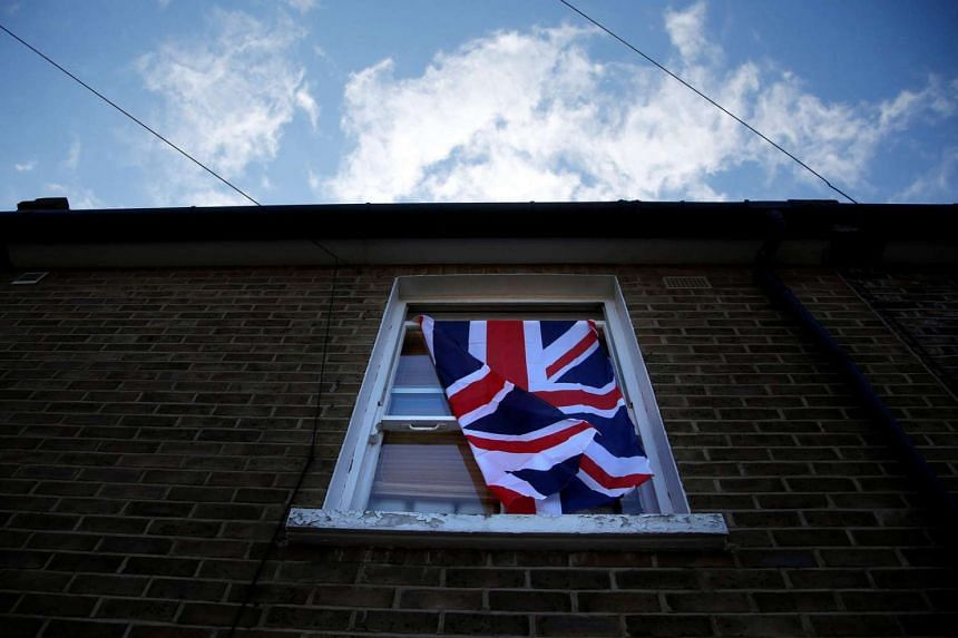 A British flag flutters in a window in London, Britain, on June 24 after Britain voted to leave the EU.