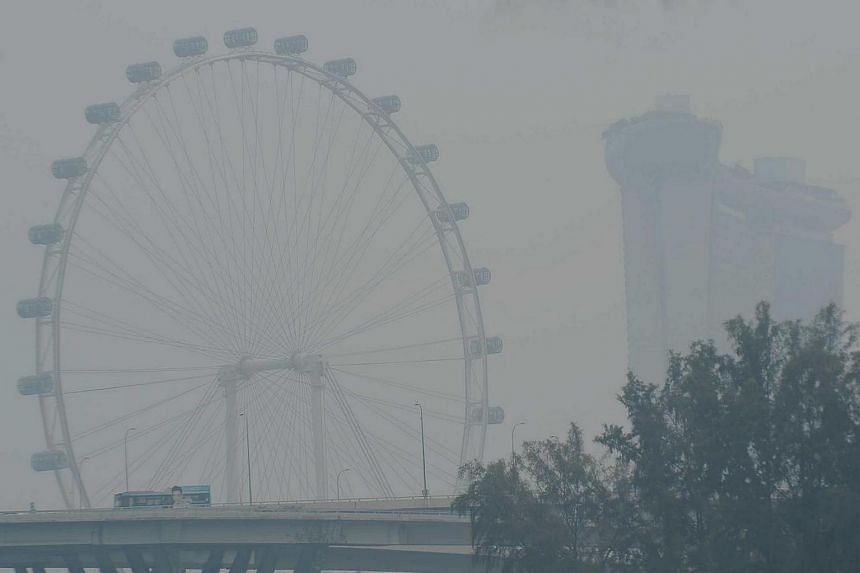The Singapore Flyer shrouded by haze on Sept 25, 2015.