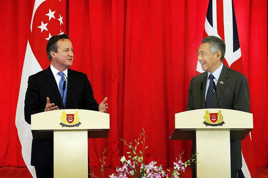 Mr Cameron (left) and Mr Lee at a press conference at the Istana on July 29, 2015.