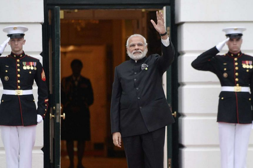 Indian Prime Minister Narendra Modi arrives for a working dinner on the South Lawn of the White House on March 31, 2016.
