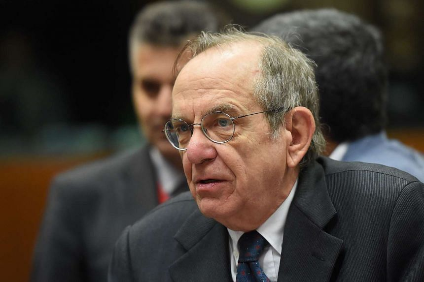 Italian Finance Minister Pier Carlo Padoan attends an Economic and Financial Affairs Council meeting in Brussels, on May 25, 2016.