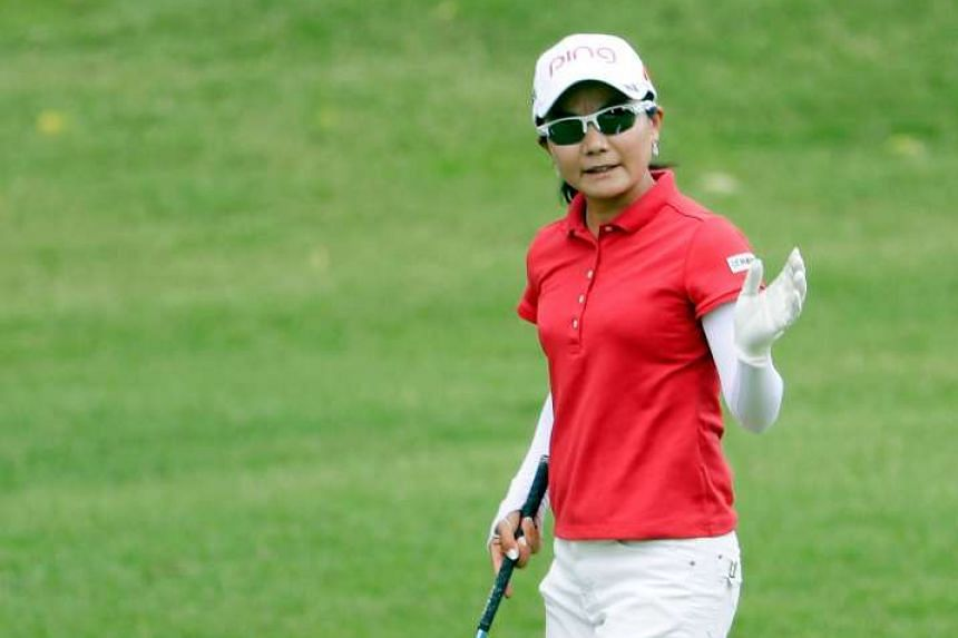 Ayako Uehara waves after hitting her second shot on the 9th hole in the first round of the Walmart NW Arkansas Championship, on June 24, 2016.