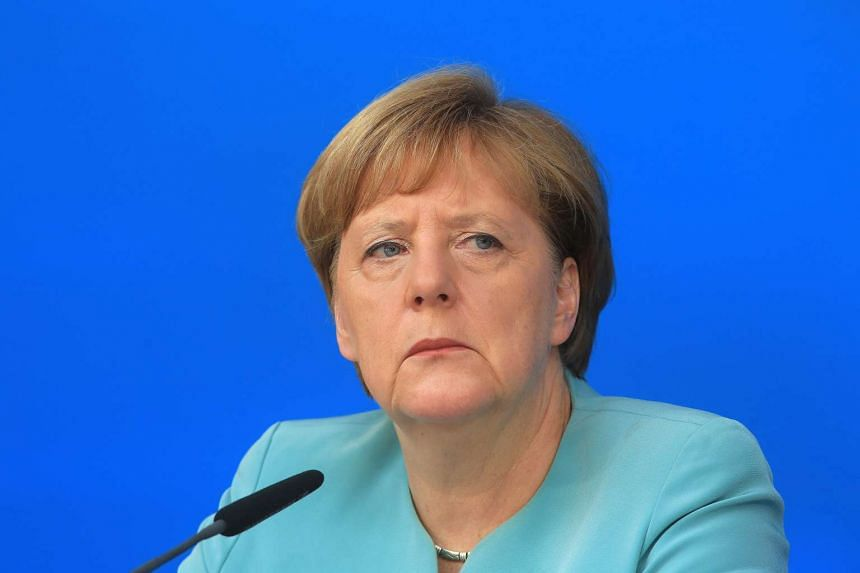 Merkel at a news conference (above) signalled that she wants to avoid punishing Britain as it leaves the EU