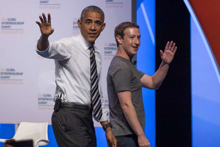 Obama (left) and Zuckerberg wave to the audience at the conclusion of their panel discussion.