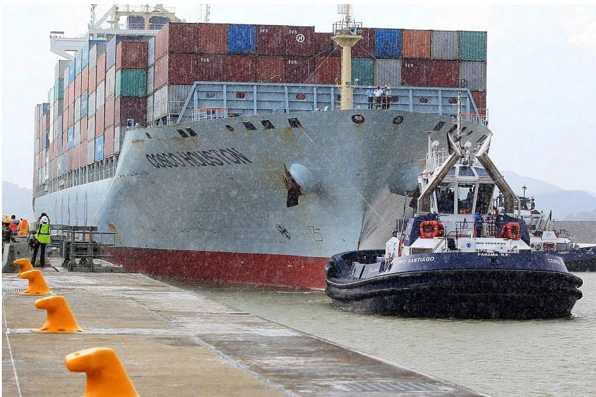 A cargo ship making a trial trip within the enlarged Panama Canal on June 23.