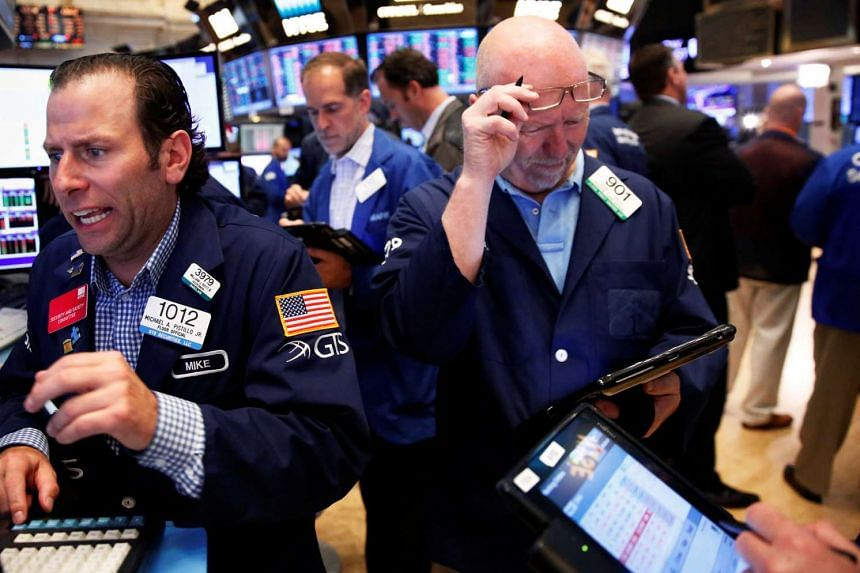 Traders work on the floor of the New York Stock Exchange on June 24, 2016.